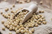 foto of soy bean  - Heap of Soy Beans on wooden background - JPG