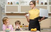 picture of morning  - Young business woman early in the morning with her little children - JPG