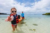 image of kayak  - Father and daughter kayaking at tropical ocean on summer vacation - JPG