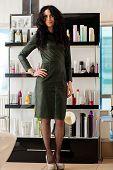 pic of beauty salon interior  - elegant woman in dress standing in the beauty salon - JPG