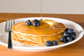 picture of wooden table  - blueberry pancakes on a plate with fork on a wooden table - JPG