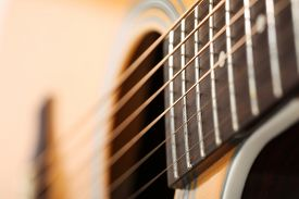 stock photo of string instrument  - Classic acoustic guitar at weird and unusual perspective closeup - JPG