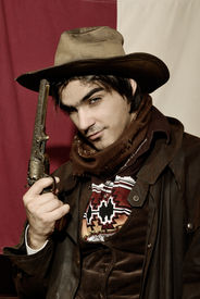 image of wild west  - handsome boy in cowboy clothes with weapon - JPG