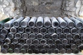 stock photo of wine cellar  - The ancient bottles of wine in the ancient cellar - JPG