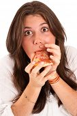 Isolated image of a young girl with a guilty surprised look eating a piece of pizza