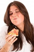 Isolated image of a young girl eating a piece of pizza with relish