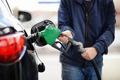 Сloseup Of Man Pumping Gasoline Fuel In Car At Gas Station poster