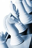 foto of chess pieces  - White knight in blue duotone - JPG