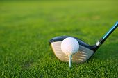 picture of golf  - Golf tee ball club driver in green grass course closeup - JPG