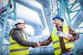 Oil refinery engineers handshake. Petrochemical and gas industry successful deal. Cooperation concep poster