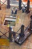 Welder & technicians at work.