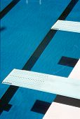 picture of swim meet  - Diving boards above a still swimming pool - JPG