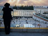 Orthodox Jewish looking to Western Wall in Jerusalem