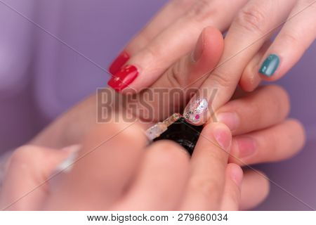 poster of Woman Receiving Fingernail Manicure Service By Professional  Manicurist At Nail Salon. Beautician Pa