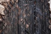 Burnt Wooden Wall Of Ruined Burned House Surface Texture. poster