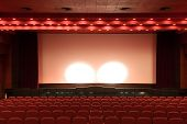 Empty Cinema Auditorium With Red Walls And Chairs