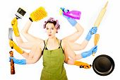 stock photo of homemaker  - A happy very busy multitasking  overworked housewife - JPG