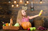 Kid Farmer With Harvest Wooden Background. Child Little Girl Enjoy Farm Life. Grow Your Own Organic  poster