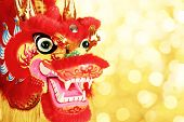 Chinese New Year Decoration--Closeup of Dancing Dragon on festive background.