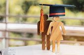Back To School Concept, People Sign Wood With Graduation Celebrating Cap On Open Textbook With Light poster