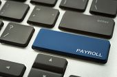 Close Up Blue Button Laptop Keyboard Selective Focus On Word Payroll. Human Resources, Salary, Accou poster