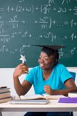 Female student in front of chalkboard   poster
