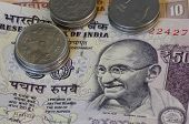 stock photo of mahatma gandhi  - notes and coins of Indian rupees detail with portrait of Gandhi - JPG