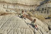 Two boys hike and explore the badlands