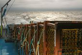 image of lobster boat  - Traps lined up on the side of a lobster boat - JPG