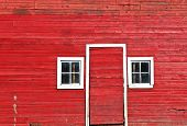 Doorway And Windows Of A Classic Red Barn