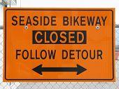 Orange Bikeway Closed Sign On  Fence
