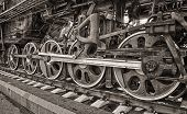 picture of locomotive  - Close up of the  wheels on an old steam locomotive - JPG