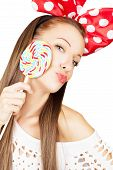 Lovely woman with colorful lollipop isolated on white