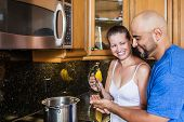 pic of she-male  - Wife gives husband a try on the food she is cooking - JPG