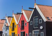 pic of row houses  - Colorful row of houses at the harbor of Zoutkamp - JPG