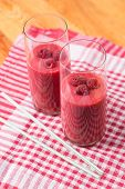Two Blended Thick Smoothie From Raspberry With Tubule
