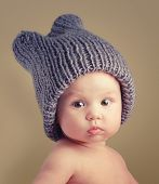 foto of amusement  - Portrait of cute happy 4 month old baby girl with funny hat - JPG