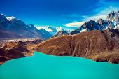 Beautiful snow-capped mountains with lake against the blue sky. Himalaya, Nepal