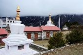 Small Stupas In Tengboche Buddhist Monastery Covered With The Cloud,everest Region,Nepal