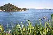 Boats on the blue sea off Hong Kong Island