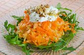 Carrot and apple salad with yogurt and walnuts