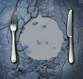 stock photo of plating  - Poverty and hunger concept with a fork and knife on a broken asphalt road shaped as a dinner plate as a social problem of food shortage hardships caused by financial distress or natural disaster resulting in living poor on the streets as a health risk - JPG