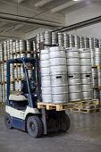 MOSCOW - OCT 16: Autoloader loading beer kegs in warehouse brewery Ochakovo on Oct 16, 2012, Moscow,