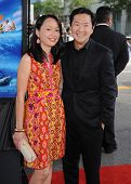LOS ANGELES - JUN 23:  Ken Jeong & wife Tran arrives to the