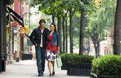 Full length of a smiling couple walking on sidewalk