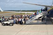 WEEZE, GERMANY - JUNE 29: People waiting in queue during the boarding to the Ryanair plane in Weeze