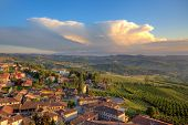 View of small typical italian town of Diano D'Alba on the hills of Langhe under beautiful sky with y