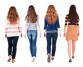 Back view of walking group of woman. Rear view people collection.  backside view of person.  Isolated over white background.