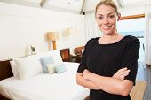 Portrait Of Hotel Chambermaid In Guest Room