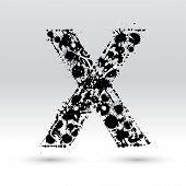 Letra X formado por manchas de tinta